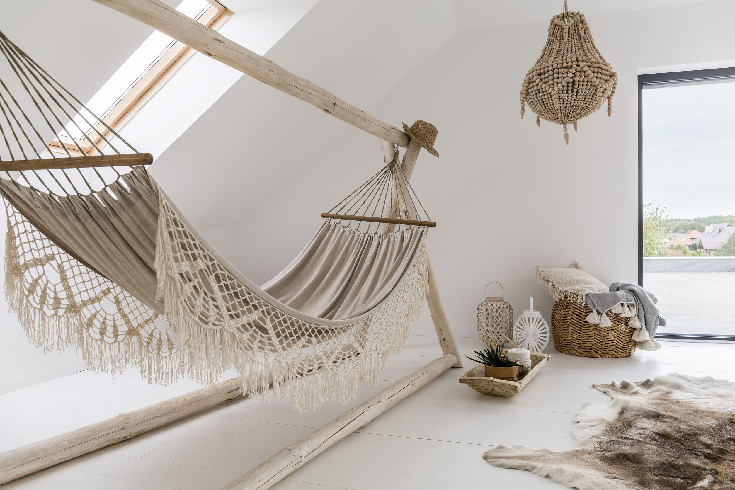 84779202 – cozy looking hammock in a stylish day room with a big chandelier